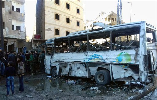 In this photo released by the Syrian official news agency SANA, Syrians gather where three bombs exploded in Sayyda Zeinab, a predominantly Shiite Muslim suburb of the Syrian capital, Syria, Sunday, Jan. 31, 2016. The triple bombing claimed by the extremi
