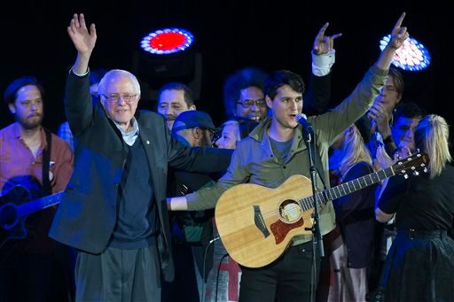 Democratic presidential candidate Sen. Bernie Sanders, I-Vt., left, and Vampire Weekend lead singer Ezra Koenig wave during a campaign rally at the University of Iowa, Saturday, Jan. 30, 2016, in Iowa City, Iowa. (AP Photo/Evan Vucci)