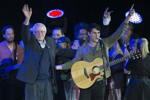 Democratic presidential candidate Sen. Bernie Sanders, I-Vt., left, and Vampire Weekend lead singer Ezra Koenig wave during a campaign rally at the University of Iowa, Saturday, Jan. 30, 2016, in Iowa City, Iowa. (AP Photo/Evan Vucci)