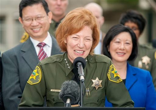 Orange County Sheriff Sandra Hutchens is all smiles as she answers questions about the capture of both outstanding jail escapees Hossein Nayeri and Jonathan Tieu are in the custody of the San Francisco during a news conference outside Orange County Sherif