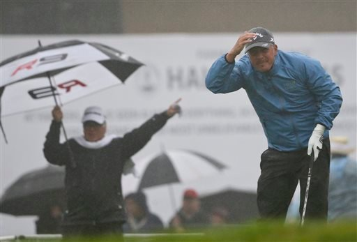 Freddie Jacobson, from Sweden, tries to follow the flight of his tee shot through the rain on the first hole of the South Course at Torrey Pines during the final round of the Farmers Insurance Open golf tournament Sunday, Jan. 31, 2016, in San Diego. The