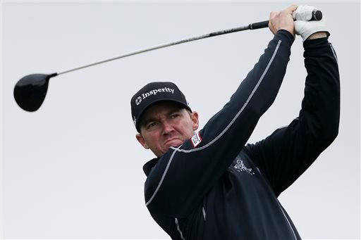 Jimmy Walker watches his tee shot on the second hole during the final round of the Farmers Insurance Open golf tournament Sunday, Jan. 31, 2016, in San Diego. (AP Photo/Gregory Bull)