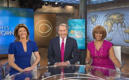 """6/19/14 image released by CBS News: co-hosts Norah O'Donnell, Charlie Rose and Gayle King appear on the set of """"CBS This Morning,"""" in New York. CBS' telecast of the big game is expected to give extra attention to the news show.(John Paul Filo/CBS via AP)"""