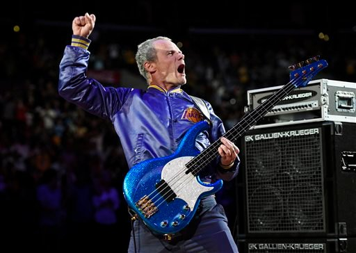 April 13, 2014 file photo, Flea, bassist for the Red Hot Chili Peppers, plays the national anthem prior to an NBA basketball game between the Los Angeles Lakers and the Memphis Grizzlies in LA. (AP Photo/Mark J. Terrill, File)