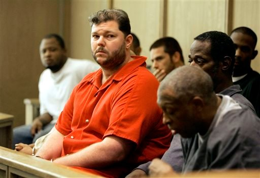 In this Sept. 23, 2005, file photo, former Oakland Raiders center Barret Robbins, left, awaits a hearing at the Miami-Dade courthouse, in Miami. (AP Photo/J. Pat Carter, File)