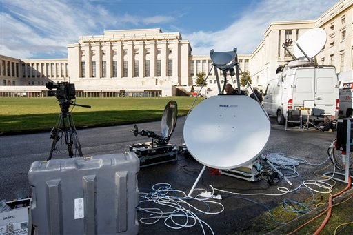 A technician sets up his TV equipment in front the UN building after Syria talks were rescheduled at the European headquarters of the United Nations in Geneva, Switzerland, Monday, Feb. 1, 2016. A spokeswoman for U.N. envoy Staffan de Mistura says indirec
