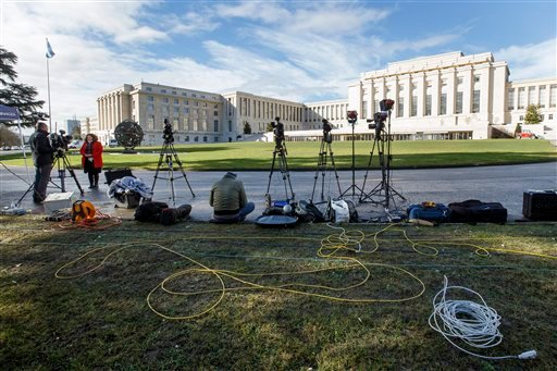 Reporters wait in front the UN building after Syria talks were rescheduled at the European headquarters of the United Nations in Geneva, Switzerland, Monday, Feb. 1, 2016. A spokeswoman for U.N. envoy Staffan de Mistura says indirect talks between the Syr