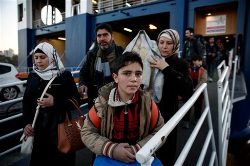 Migrants and refugees disembark from a ferry after their arrival at the port of Piraeus near Athens, Sunday, Jan. 31, 2016. Europe has endured a huge influx of migrants, most of whom undertake a dangerous journey in search of a better life. On Saturday, a