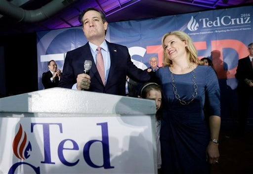 Republican presidential candidate, Sen. Ted Cruz, R-Texas, arrives for a caucus night rally with his wife Heidi, and daughter Caroline, 7, Monday, Feb. 1, 2016, in Des Moines, Iowa.