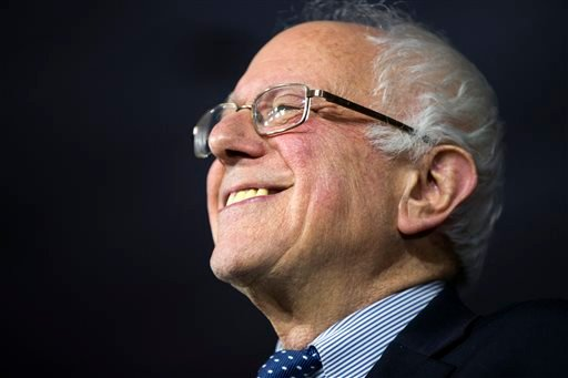 Democratic presidential candidate Sen. Bernie Sanders, I-Vt., smiles during a caucus night rally on Monday, Feb. 1, 2016, in Des Moines, Iowa. (AP Photo/Evan Vucci)