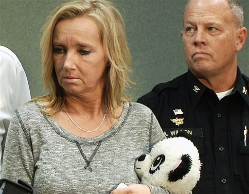 """Tammy Weeks holds one of her slain daughter's stuffed pandas during a news conference in Blacksburg, Va., on Tuesday, Feb. 2, 2016. Weeks says her 13-year-old daughter, Nicole Lovell, fought health problems all her life and had dreams of singing on """"Ameri"""