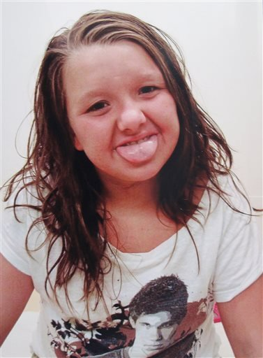 This undated photo provided by Tammy Weeks shows her daughter, Nicole Lovell, posing when she was 10 in Blacksburg, Va. The 13-year-old girl was found dead just across the state line in Surry County, N.C., and two Virginia Tech students are charged in the