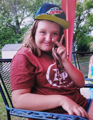 In this 2015 photo provided by Tammy Weeks, her daughter, Nicole Lovell, flashes a peace sign in Blacksburg, Va. The 13-year-old girl was found dead just across the state line in Surry County, N.C., and two Virginia Tech students are charged in the case.