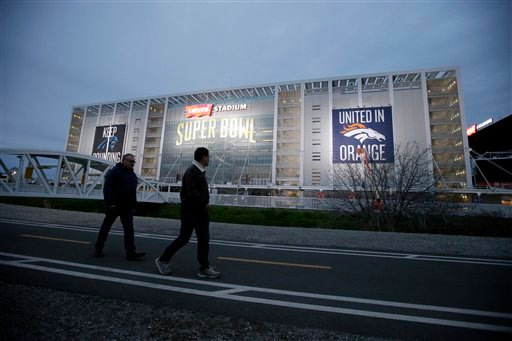 Visitors walk in front of Levi's Stadium Saturday, Jan. 30, 2016, in Santa Clara, Calif. Super Bowl 50, between the Carolina Panthers and Denver Broncos, will be played at Levi's Stadium Feb. 7. (AP Photo/Marcio Jose Sanchez)