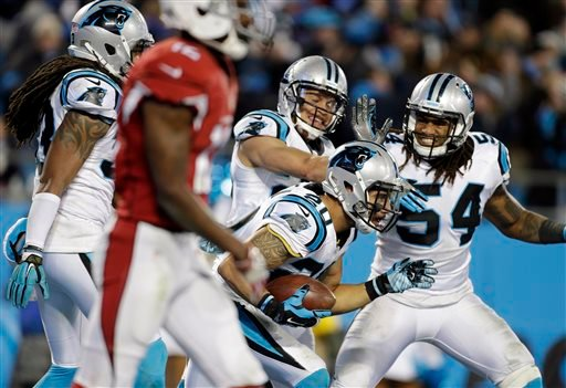 Jan. 24, 2016, file photo, Carolina Panthers' Kurt Coleman is congratulated after intercepting a pass during the first half the NFL football NFC championship game against the Arizona Cardinals in Charlotte, N.C. (AP Photo/Bob Leverone, File)