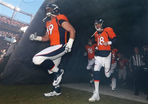 Jan. 3, 2016, file photo, Denver Broncos quarterback Peyton Manning (18) and lineman Evan Mathis (69) take the field for an NFL football game against the San Diego Chargers in Denver. (AP Photo/Jack Dempsey, File)