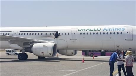 A hole is seen in a plane operated by Daallo Airlines as it sits on the runway of the airport in Mogadishu, Somalia.  AP