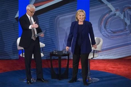 Democratic presidential candidate Hillary Clinton, right, stands to answer a question from the audience alongside host Anderson Cooper during a Democratic primary town hall sponsored by CNN, Wednesday, Feb. 3, 2016, in Derry, N.H. (AP Photo/John Minchillo