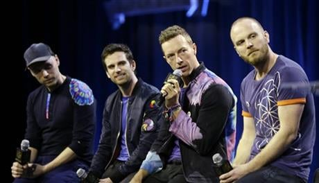 Jonny Buckland, left to right, Guy Berryman, Chris Martin and Will Champion of Coldplay answer questions during a halftime news conference for the upcoming NFL Super Bowl 50 football game Thursday, Feb. 4, 2016, in San Francisco. (AP Photo)