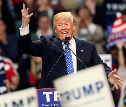 Republican presidential candidate Donald Trump gestures as he speaks at a campaign rally Friday, Feb. 5, 2016, in Florence, S.C.