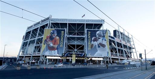 Banners for the Denver Broncos and Carolina Panthers hang outside Levi's Stadium in advance of Sunday's NFL Super Bowl 50 football game Friday, Feb. 5, 2016, in Santa Clara, Calif.