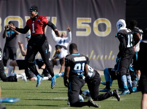 Carolina Panthers quarterback Cam Newton (1) jumps as his teammates stretch during practice in preparation for the Super Bowl 50 football game Friday Feb. 5, 2016 in San Jose, Calif.