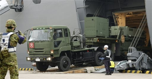 A vehicle carrying a PAC-3 missile interceptor arrives at a port on Ishigaki Island, Okinawa prefecture, southwestern Japan Saturday, Feb. 6, 2016.