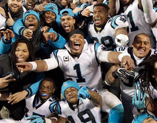 Carolina Panthers' Cam Newton celebrates with teammates during the second half the NFL football NFC Championship game against the Arizona Cardinals Sunday, Jan. 24, 2016, in Charlotte, N.C. (AP Photo/Chuck Burton)