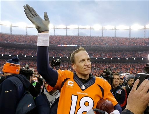Denver Broncos quarterback Peyton Manning waves to spectators following the AFC Championship game between the Denver Broncos and the New England Patriots, Sunday, Jan. 24, 2016, in Denver. (AP Photo/Chris Carlson)