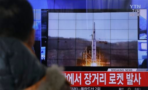 A South Korean man watches a TV news program with a file footage about North Korea's rocket launch at Seoul Railway Station in Seoul, South Korea Feb. 7, 2016.  (AP Photo/Ahn Young-joon)