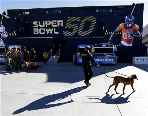 Military personnel stands guard outside Levi's Stadium before the NFL Super Bowl 50 football game between the Denver Broncos and the Carolina Panthers, Sunday, Feb. 7, 2016, in Santa Clara, Calif. (AP Photo/Gregory Bull)