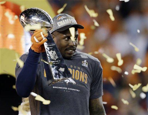 Denver Broncos' Von Miller holds the trophy after the NFL Super Bowl 50 football game Sunday, Feb. 7, 2016, in Santa Clara, Calif. The Broncos won 24-10.