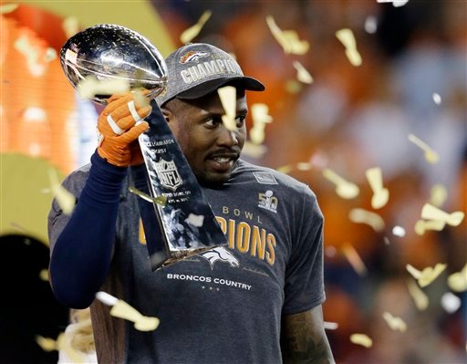 Denver Broncos' Von Miller holds the trophy after the NFL Super Bowl 50 football game Sunday, Feb. 7, 2016, in Santa Clara, Calif. The Broncos won 24-10.