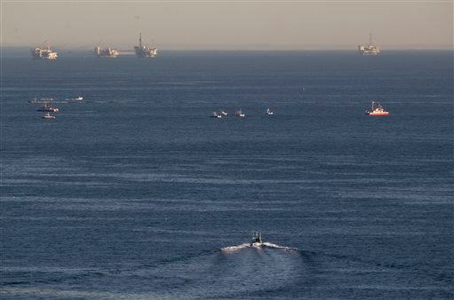 Rescue boats search for wreckage from two small planes that collided in midair and plunged into the ocean off of Los Angeles harbor Friday, Feb. 5, 2016, in San Pedro, Calif.