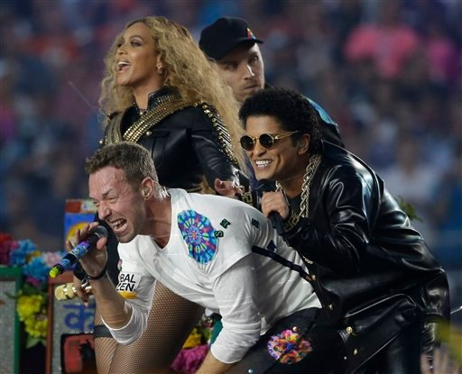 Coldplay singer Chris Martin performs with Beyoncé and Bruno Mars during halftime of the NFL Super Bowl 50 football game Sunday, Feb. 7, 2016, in Santa Clara, Calif.