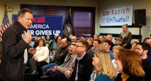Republican presidential candidate, Ohio Gov. John Kasich speaks during a campaign stop at the public library before next Tuesday's first in the nation presidential primary, Monday, Feb. 8, 2016, in Plaistow,NH (AP Photo/Jim Cole)