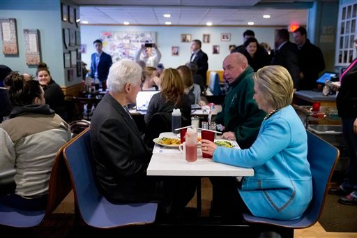 Democratic presidential candidate Hillary Clinton and her husband former President Bill Clinton, have breakfast, Monday, Feb. 8, 2016, at Chez Vachon restaurant in , N.H. (AP Photo/Matt Rourke)