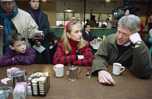 In this Feb. 15, 1992 file photo, Andrew Dodwell listen as left, as Democratic presidential candidate, Arkansas Gov. Bill Clinton, accompanied by his wife Hillary Clinton stop at a restaurant in Manchester, N.H. for a cup of coffee prior to a door-to-door