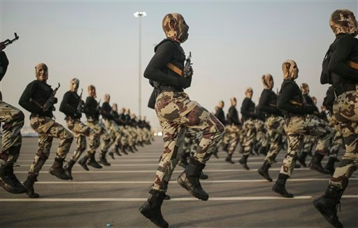 In this Thursday, Sept. 17, 2015 file photo, Saudi security forces take part in a military parade in preparation for the annual Hajj pilgrimage in Mecca, Saudi Arabia. Saudi Arabia's offer to put boots on the ground to fight Islamic State in Syria is as m