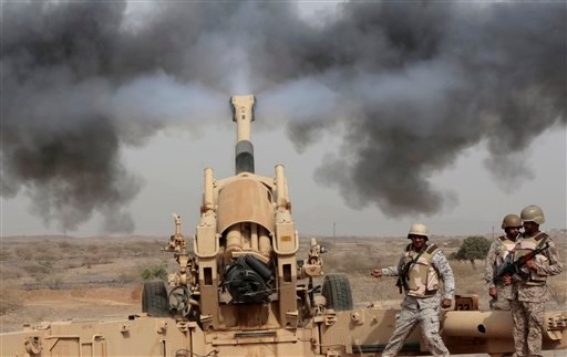In this April 20, 2015 file photo, Saudi soldiers fire artillery toward three armed vehicles approaching the Saudi border with Yemen in Jazan, Saudi Arabia. Saudi Arabia's offer to put boots on the ground to fight Islamic State in Syria is as much about t