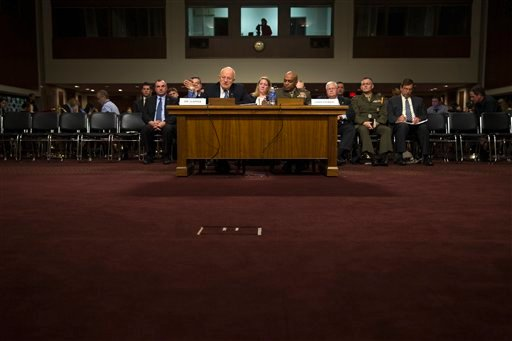 Director of National Intelligence James Clapper, left, accompanied by Defense Intelligence Agency Director Lt. Gen. Vincent Stewart, testifies on Capitol Hill in Washington, Tuesday, Feb. 9, 2016, before a Senate Armed Services Committee hearing on worldw