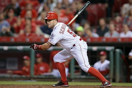 In this May 26, 2015, file photo, Cincinnati Reds' Skip Schumaker watches his his game-winning double in the ninth inning of a baseball game against the Colorado Rockies in Cincinnati.