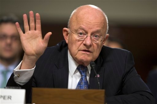 Director of National Intelligence James Clapper testifies on Capitol Hill in Washington, Tuesday, Feb. 9, 2016, before a Senate Armed Services Committee hearing on worldwide threats. (AP Photo/Evan Vucci)