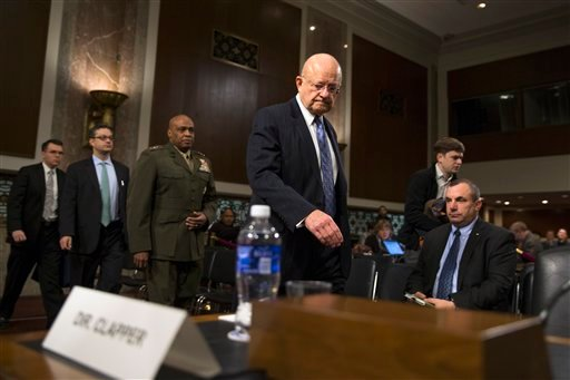 Director of National Intelligence James Clapper, center, and Defense Intelligence Agency Director Lt. Gen. Vincent Stewart, arrive on Capitol Hill in Washington, Tuesday, Feb. 9, 2016, for a Senate Armed Services Committee hearing on worldwide threats. (A