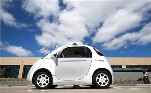 FILE - This May 13, 2015, file photo, shows Google's new self-driving car during a demonstration at the Google campus in Mountain View, Calif.