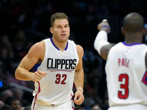 In this Sunday, Nov. 29, 2015 file photo, Los Angeles Clippers guard Chris Paul, right, acknowledges forward Blake Griffin after Griffin scored during the second half of an NBA basketball game against the Minnesota Timberwolves in Los Angeles.