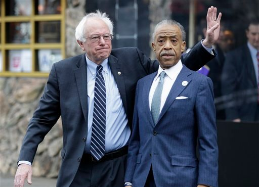 Democratic presidential candidate Sen. Bernie Sanders, I-Vt., left, waves to media and supporters after a breakfast meeting with Al Sharpton at Sylvia's Restaurant, Wednesday, Feb. 10, 2016, in the Harlem neighborhood of New York. Sanders defeated former