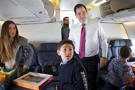 Republican presidential candidate, Sen. Marco Rubio, R-Fla. boards a plane with his family and staff to leave Manchester, N.H., Wednesday Feb. 10, 2016, en route to South Carolina, after the New Hampshire primary. With him is daughter Amanda Rubio, 15, le