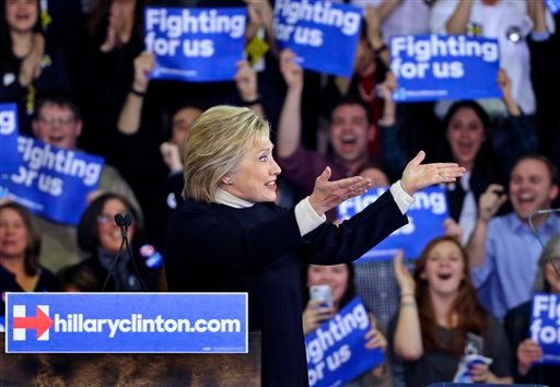 Democratic presidential candidate Hillary Clinton gestures to supporters at her New Hampshire presidential primary campaign rally, Tuesday, Feb. 9, 2016, in Hooksett, N.H. (AP Photo/Elise Amendola)