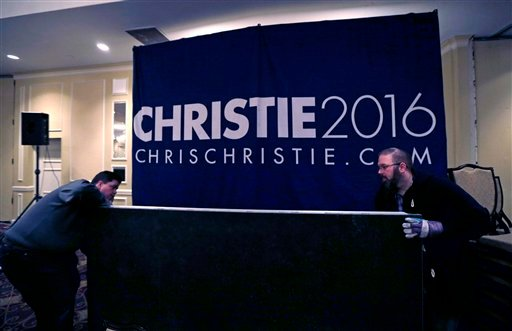 Campaign workers breaking down the primary night rally stage for Republican presidential candidate, New Jersey Gov. Chris Christie in Nashua, N.H., early Wednesday morning, Feb. 10, 2016. (AP Photo/Charles Krupa)